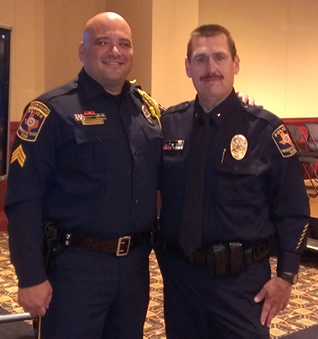 Sgt. Barrera and Inspector Charlie Patnode, both of whom grew up together at UTSA PD, share a moment together at the May 2013 UTSP Academy graduation