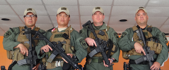 Sergeant Barrera was an original member of the System Rapid Response Team and is shown here (far right) with other members from the UT San Antonio Police
